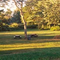 The 2.4-acre park includes picnic areas with several barbecue grill areas.- Burying Hill Beach