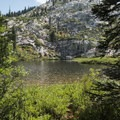 Little Castle Lake from a backcountry campsite.- Little Castle Lake