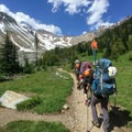 A climbing team makes their way to the end of the maintained trail in Glacier Basin.- Mount Rainier: Emmons-Winthrop Glacier Route
