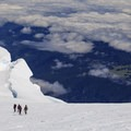 Descending back down to the Russell Cliff/Columbia Crest saddle plateau.- Mount Rainier: Emmons-Winthrop Glacier Route