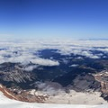 Panorama above the clouds with Russell Cliff on the left.- Mount Rainier: Emmons-Winthrop Glacier Route