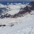 A rope team descends the Emmons Glacier with Little Tahoma above and to the right.- Mount Rainier: Emmons-Winthrop Glacier Route