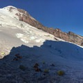 Panorama of Camp Schurman with the Ranger Cabin on the left, the summit above and to the left, and Curtis Ridge to the right.- Mount Rainier: Emmons-Winthrop Glacier Route