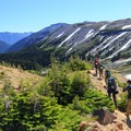 Hiking back down to Glacier Basin and the White River Canyon.- Mount Rainier: Emmons-Winthrop Glacier Route