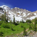 Snow and dust blowing up high as seen from Glacier Meadows.- Mount Rainier: Emmons-Winthrop Glacier Route