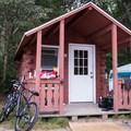 Cabins L through N sit on a quiet waterfront and are perfect to pitch tents next to if the whole family can't fit.- Burlingame State Park Campground