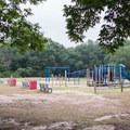 The playground is next to the general store and has a great open field next to it for lawn games.- Burlingame State Park Campground