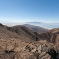 View south near Frary Peak summit, Oquirrh Mountains in the distance.- Frary Peak
