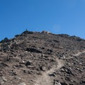 A hiker taking in the view from Frary Peak.  - Frary Peak