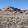 The trail passes through sagebrush and rockier terrain as it climbs toward the ridgeline.  - Frary Peak