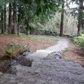 The path gently winds through the park.- Big Rock Garden