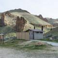 Vault toilets at Slocum Creek Campground.- Slocum Creek Campground