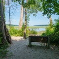 A bench looks over the Hudson at the picnic area.- Saugerties Lighthouse