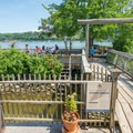 A picnic area on the dock adjacent to the lighthouse.- Saugerties Lighthouse