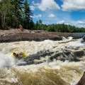 Garburator is a powerful crashing wave that offers up HUGE moves.- Ottawa River: Main Channel
