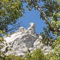 Granite outcroppings loom over the Little Cottonwood Trail.- Little Cottonwood Trail