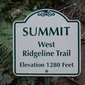 Sign marking the summit of the west Ridgeline Trail System.- Ridgeline Trail System: Blanton Trailhead