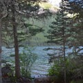 View of Bowman Lake from a tent site.- Head of Bowman Lake Campground