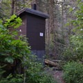 A vault toilet is available at Head of Bowman Lake Campground.- Head of Bowman Lake Campground