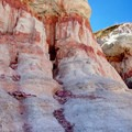 Multiple layers, representing millions of years of geological history.- Paint Mines Interpretive Park