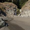 Miller Creek creates a small waterfall onto Secret Beach.- Secret Beach