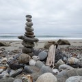 A cairn sits on the beach.- Mill Creek Beaches + Picnic Area