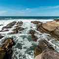Fingers of rock jut into the sea.- Bluff Trail Hike