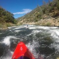 Attempting to avoid the large rocks in Meatgrinder.- South Fork of the American River: Chili Bar to Coloma
