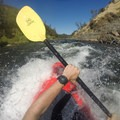 Slamming into a drop and creating a large splash.- South Fork of the American River: Chili Bar to Coloma