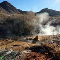 Hot water channeled through shallow canals at Mystic Hot Springs..- Mystic Hot Springs