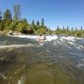 A kayaker surfs in Barking Dog.- South Fork of the American River: Coloma to Greenwood (C to G)
