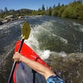 Scraping the edge of a boulder.- South Fork of the American River: Coloma to Greenwood (C to G)