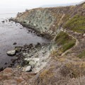 An old trail winds down the cliffside into the cove.- Jade Cove