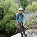 A climber prepares to rappel from the observation platform at Castle Rock Falls.- Castle Rock Falls Waterfall Cliff