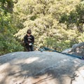 A young climber tops out on The Layback (5.6).- Castle Rock Falls Waterfall Cliff