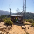 Radio towers and a building at the top.- Buzzard's Roost Trail