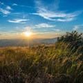 The setting sun over Cascade's summit.- Cascade + Porter Mountains