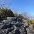 Rocky scramble up to the fire tower.- Standing Indian Loop