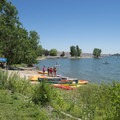 Stand-up paddle rental at West Shades Day Use Area, Cherry Creek State Park.- West Shades Swim Beach + Day Use Area