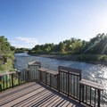 Fishing pier at South Platte Park on the South Platte River.- South Platte Park