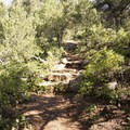 The ascent to the summit of Green Mountain begins at a set of stairs near its base.- Green Mountain Trail + Exclamation Point