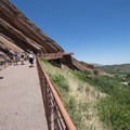 Entry ramp leading up to Red Rocks Amphitheater.- Red Rocks Amphitheater + Park