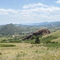 View south from Red Rocks Park of the red sandstone Fountain Formation.- Red Rocks Amphitheater + Park