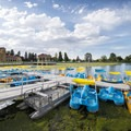 Ferril Lake, paddle boat rentals, the City Park Pavilion and band stand.- City Park