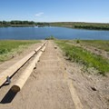 Steep decline boat ramp for small watercraft at Dixon Reservoir.- Dixon Reservoir Loop Trail