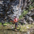 Crossing the creek with a smile.- Paulina Creek Waterfalls Mountain Biking