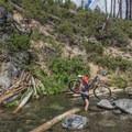 Making the crossing along the ride to Paulina Creek Waterfalls.- Paulina Creek Waterfalls Mountain Biking
