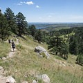 Hiker's descending Arthur's Rock Trail.- Arthur's Rock Hike