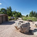 Vault toilet facility at the Soderberg Open Space parking area.- Stout, Sawmill + Nomad Trail Loop