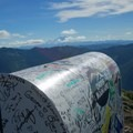 Backside of the mailbox with Mount Rainier in the distance.- Mailbox Peak via the Old Trail